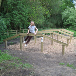 Girl using a Fitness Trail station
