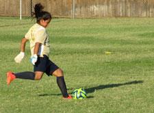 Girl kicking a football