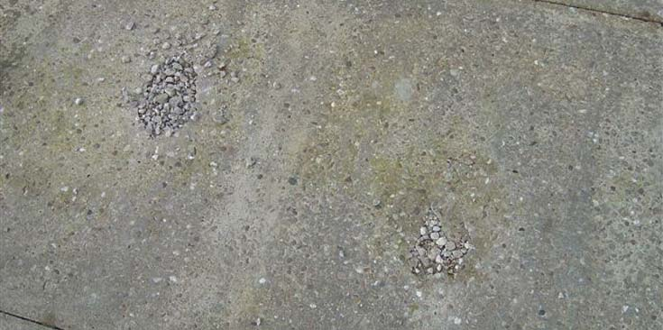 Cracked and extremely worn concrete base.