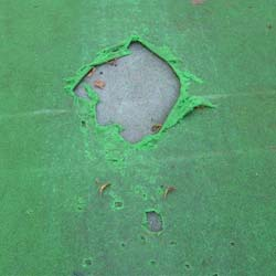 Damage caused by spikes, exposing the cricket base pad.